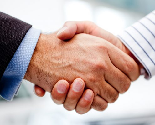 Business handshake of two men closing a deal